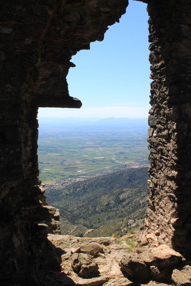 Spain, as seen through a window of Castell de Sant Salvador, above Sant Pere de Rodes.